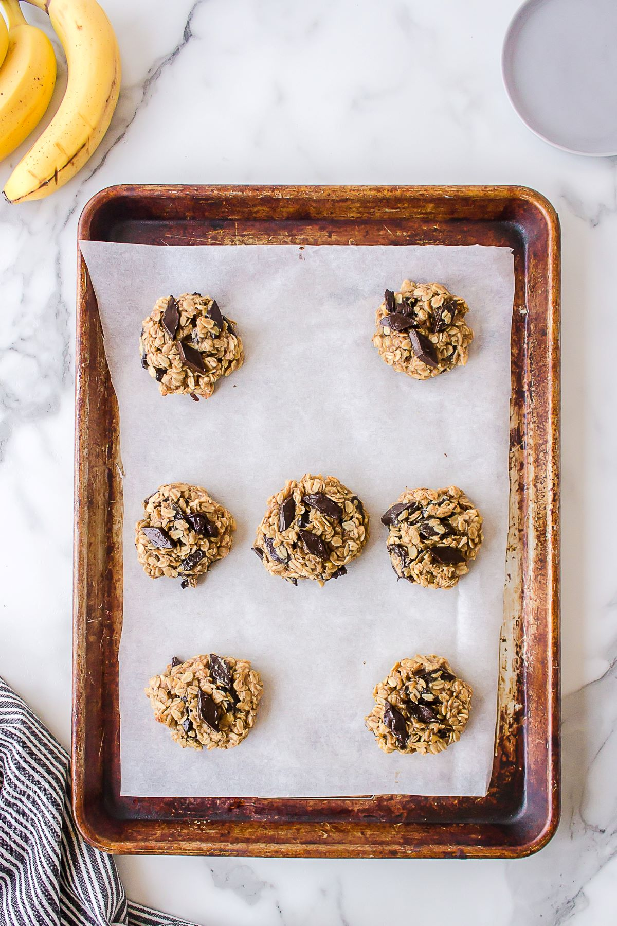 Breakfast cookies on a sheet pan lined with parchment