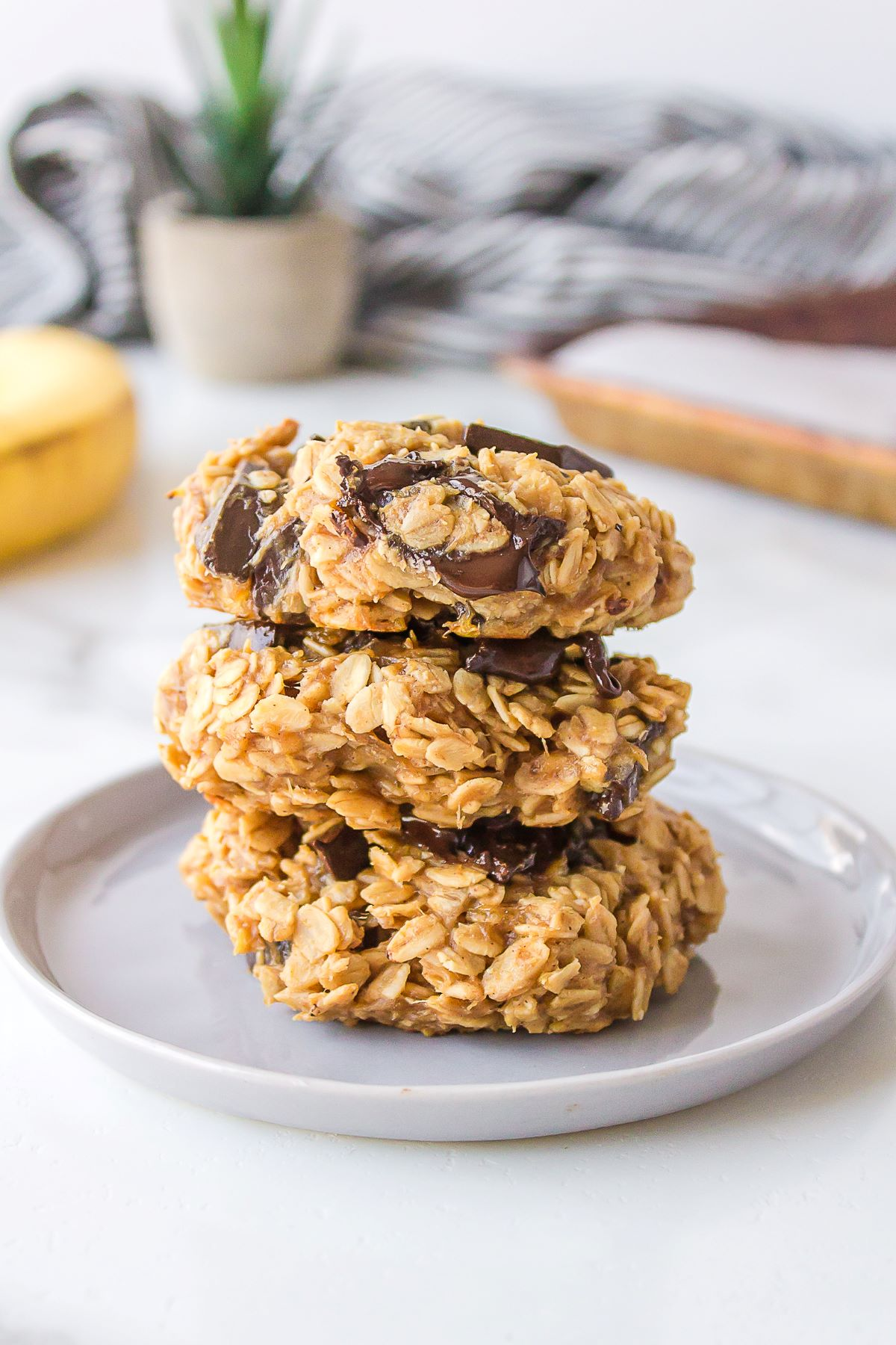 Three baked breakfast cookies, stacked on top of each other.